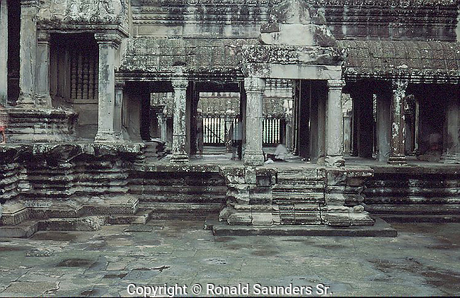 Angkor Wat (Khmer:)was first a Hindu, then subsequently a Buddhist, temple complex in Cambodia and the largest religious monument in the world. The temple was built by the Khmer King Suryavarman II in the early 12th century in Yaśodharapura (Khmer: យសោធរបុរៈ, present-day Angkor), the capital of the Khmer Empire, as his state temple and eventual mausoleum. Breaking from the Shaiva tradition of previous kings, Angkor Wat was instead dedicated to Vishnu. As the best-preserved temple at the site, it is the only one to have remained a significant religious center since its foundation. The temple is at the top of the high classical style of Khmer architecture. It has become a symbol of Cambodia,[1] appearing on its national flag, and it is the country's prime attraction for visitors.