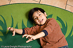 Education Preschool 3-5 year olds pretend play boy making claws with his hands and growling looking at camera viewer horizontal
