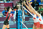 Wing spiker Yurie Nabeya (L) of Japan hits the ball during the FIVB Volleyball World Grand Prix - Hong Kong 2017 match between Japan and Serbia on 22 July 2017, in Hong Kong, China. Photo by Yu Chun Christopher Wong / Power Sport Images