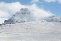 Uncompahgre Peak engulfed in morning clouds.