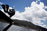 Scuba experts dive from the Tiquina Bolivian Navy Base into Lake Titicaca. Bolivia lost what is now northern Chile in a war over nitrates leaving Bolivia without access to the ocean.