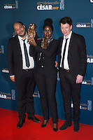"""French film producers Christophe Barral (R) and Toufik Ayadi (L) pose with French film director Alice Diop (C) during a photocall after winning the Best Short Film award for """"Vers la tendresse"""" (To the tenderness) during the 42nd edition of the Cesar Ceremony at the Salle Pleyel in Paris on February 24, 2017."""