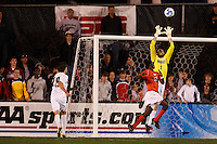 Wake Forest Demon Deacons goalkeeper Brian Edwards (1) grabs a ball in front of Virginia Tech Hokies forward Patrick Nyarko (12) during an NCAA College Cup semi-final match at SAS Stadium in Cary, NC on December 14, 2007. Wake Forest defeated Virginia Tech 2-0.
