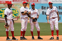 (L-R) Enrique Cruz (9), Caonabo Cosme (30), Luis Bolivar (10) and Adam Rosales (27) chat while a relief pitcher warms-up at AT&T Field in Chattanooga, TN, Wednesday, July 25, 2007.