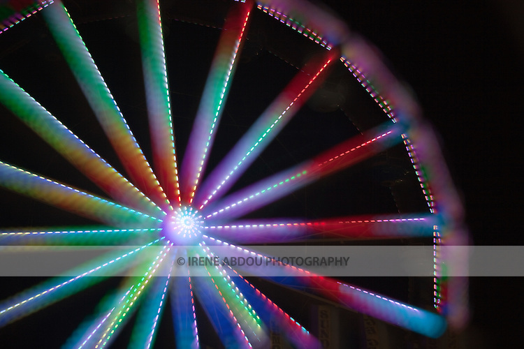 """A photography technique called """"focus blur"""" is used to transform the lights of the ferris wheel into abstract designs at the Montgomery County Agricultural Fair in Gaithersburg, Maryland."""