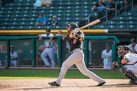 Tim Smalling (8) of the Albuquerque Isotopes at bat against the Salt Lake Bees in Pacific Coast League action at Smith's Ballpark on June 8, 2015 in Salt Lake City, Utah.   The Bees defeated the Isotopes 10-7 in game one of a double-header. (Stephen Smith/Four Seam Images)