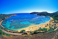 Hanauma Bay. A marine life conservation area know for it's abundant reef fishes and coral reefs.  One of oahu's more popular tourist attractions.