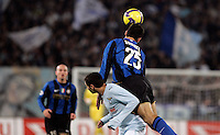 Football, Italian serie A: Lazio vs Inter Milan. Rome, Olympic stadium, 6 december 2008. Inter Milan defender Walter Samuel, of Argentine, rigth, and Lazio forward Mauro Zarate, of Argentina, jump for the ball..Calcio, Serie A: Lazio vs Inter. Roma, stadio Olimpico, 6 dicembre 2008..UPDATE IMAGES PRESS/Riccardo De Luca