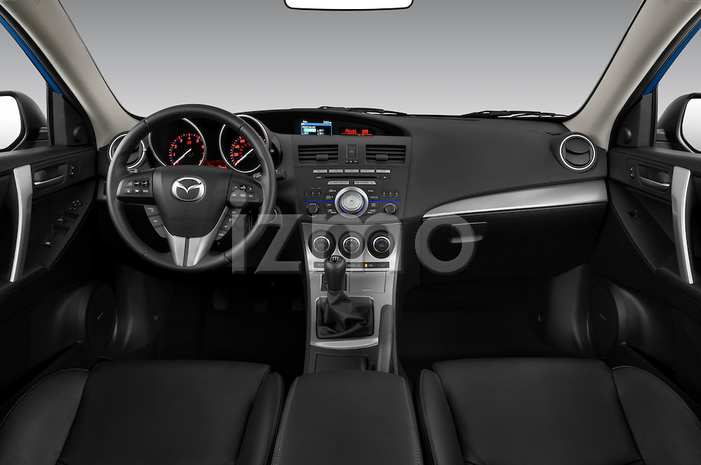 Straight dashboard view of a 2010 Mazda 3 5-Door S Grand Touring.