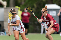 NEWTON, MA - MAY 14: Maddy Moloney #17 of University of Massachusetts looks to pass as Meghan Hoffman #22 of Temple University defends during NCAA Division I Women's Lacrosse Tournament first round game between University of Massachusetts and Temple University at Newton Campus Lacrosse Field on May 14, 2021 in Newton, Massachusetts.