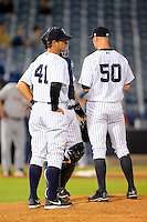 Tampa Yankees pitching coach Jeff Ware #41 talks with pitcher Zach Arneson #50 and catcher Gary Sanchez #35 during a game against the Lakeland Flying Tigers at Steinbrenner Field on April 6, 2013 in Tampa, Florida.  Lakeland defeated Tampa 8-3.  (Mike Janes/Four Seam Images)
