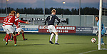 Mark Beck turns the ball past keeper Kevin Cuthbert to score for Falkirk