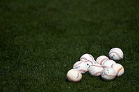 Pittsburgh Pirates baseballs sit in the grass during warmups before a Major League Spring Training game against the Minnesota Twins on March 16, 2021 at Hammond Stadium in Fort Myers, Florida.  (Mike Janes/Four Seam Images)