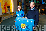Christine O'Sullivan from Mounthawk Tralee who is a 4th year student in UCC and is raising funds called T4T €2 for Tanzania and is standing with Fr Padraig Walsh in St Brendans Church on Saturday evening.