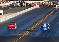 Jul. 25, 2014; Sonoma, CA, USA; NHRA pro stock driver Larry Morgan (right) races alongside V. Gaines during qualifying for the Sonoma Nationals at Sonoma Raceway. Mandatory Credit: Mark J. Rebilas-