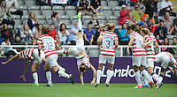 Newcastle, England - Friday, August 3, 2012: The USA women defeated New Zealand 2-0 in the quarterfinal round of the 2012 Olympics at St. James Park. The USA celebrates an Abby Wambach goal with cartwheels.
