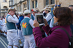 May day morning Japanese tourist taking photograph of Morris dancers using their ipad tablets mobile devise Oxford Oxfordshire 2013 2010s UK