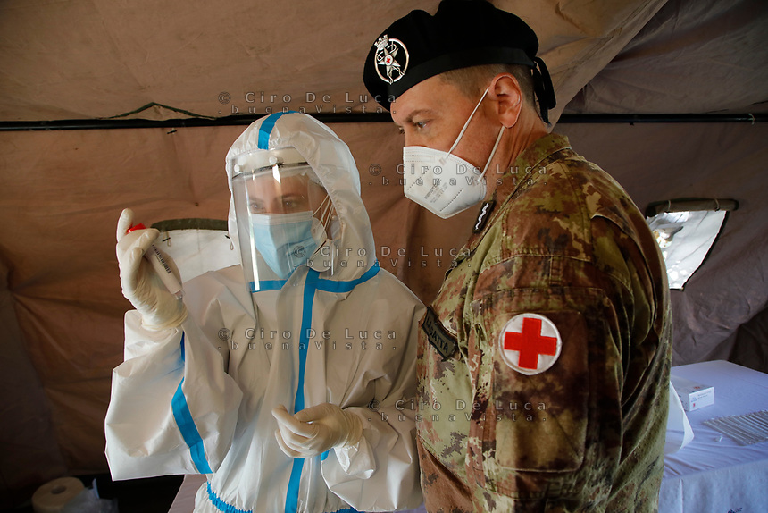 Military tents swet up to take a swabs for  public in the Frullone Hospital in Naples