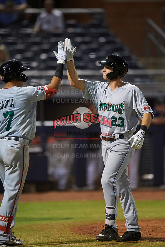 Surprise Saguaros Brewer Hicklen (23), of the Kansas City Royals organization, is congratulated by Luis Garcia (7) after hitting a home run to right field during an Arizona Fall League game against the Peoria Javelinas on September 22, 2019 at Peoria Sports Complex in Peoria, Arizona. Surprise defeated Peoria 2-1. (Zachary Lucy/Four Seam Images)