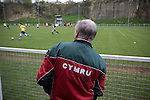 Cefn Druids AFC 1 Buckley Town 0, 12/04/2014. The Rock, Cymru Alliance league. A man in a Wales tracksuit watching the second half action at The Rock, Rhosymedre, home to Cefn Druids AFC, during the club's final home game of the season against Buckley Town (in yellow) in the Cymru Alliance league. Druids, reputedly the oldest football club in Wales, won the Alliance league the previous week and were awarded the trophy after the Buckley Town match, which they won by 1 goal to nil, watched by a crowd of 246. The Cymru Alliance was the second tier of Welsh football based in north and mid Wales, promotion from which led directly into the Welsh Premier League. Photo by Colin McPherson.