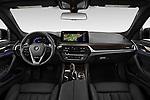 Stock photo of straight dashboard view of 2021 BMW 5-Series 530i-Sport 4 Door Sedan Dashboard