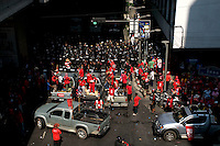 """""""Red Shirt"""" protesters are met by Riot police in riot gear in Chidlom one of Bangkok's busy business areas in the city centre."""