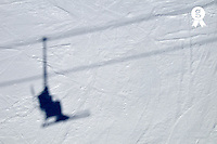 Shadow of skier on ski lift, French Alps (Licence this image exclusively with Getty: http://www.gettyimages.com/detail/92907719 )