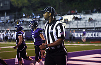 Referee Sparky Hamilton officiates, Friday, October 9, 2020 during a football game at Fayetteville High School in Fayetteville. Check out nwaonline.com/2010010Daily/ for today's photo gallery. <br /> (NWA Democrat-Gazette/Charlie Kaijo)