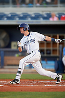 Charlotte Stone Crabs second baseman Justin Bridgman (24) follows through on a swing during a game against the Palm Beach Cardinals on April 20, 2018 at Charlotte Sports Park in Port Charlotte, Florida.  Charlotte defeated Palm Beach 4-3.  (Mike Janes/Four Seam Images)