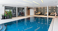 BNPS.co.uk (01202 558833)<br /> Pic: HamptonsInternational/BNPS<br /> <br /> Stunning indoor swimming pool complex...<br /> <br /> A futuristic 'Hollywood Hills' home which is nestled in the English countryside has emerged on the market for almost £5million.<br /> <br /> Harwin, in Bourne End, Bucks, would not look out of place on the big screen with its striking modern design.<br /> <br /> The five bedroom property which offers stunning views of the Thames Valley has its own cinema, gym and swimming pool.<br /> <br /> It is being sold with estate agent Hamptons International with a guide price of £4.75million.