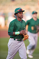 Beloit Snappers shortstop Marcos Brito (6) jogs off the field between innings of a Midwest League game against the Lansing Lugnuts at Cooley Law School Stadium on May 4, 2019 in Lansing, Michigan. Beloit defeated Lansing 2-1. (Zachary Lucy/Four Seam Images)