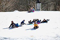 NEW YORK, NEW YORK - FEBRUARY 21: Children slides in Central Park while is covered by snow and ice  on February 21, 2021 in New York City. The big apple waits this monday the last snowfall before a midweek warm up.  (Photo by John Smith/VIEWpress via Getty Images)