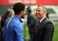 (L-R) Ashley Williams of Everton speaks to Swansea ambassador Lee Trundle prior to the Premier League match between Swansea City and Everton at The Liberty Stadium, Swansea, Wales, UK. Saturday 06 May 2017