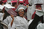NAUGATUCK, CT - 20 June 2004 - 062204BZ12- Raquel Pinckney holds her diploma up to show family and friends during commencement excercises at Naugatuck High School Tuesday night.<br />Jamison C. Bazinet Photo