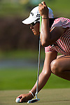 CHON BURI, THAILAND - FEBRUARY 20:  Yani Tseng of Taiwan lines up a putt on the 17th green during day four of the LPGA Thailand at Siam Country Club on February 20, 2011 in Chon Buri, Thailand. Photo by Victor Fraile / The Power of Sport Images