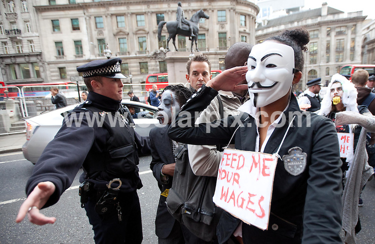 **ALL ROUND PICTURES FROM SOLARPIX.COM**                                             **NO UK NEWSPAPER PUBLICATION**.**UK MAGAZINE & SUPPLEMENT PUBLICATION ONLY** AND NO PUBLICATION IN AUSTRALIA, BELGIUM, FRANCE, GERMANY, ITALY, SCANDINAVIA AND USA**                                                                                  Occupiers from Occupy London held a flash mob dance protest, dressed as zombie bankers. .The demonstration began behind  St Paul's cathedral, before moving through the City of London..Picture shows: Protesters at  Bank                                                                               JOB REF:  14133      SFE       DATE:   31.10.11                                                         **MUST CREDIT SOLARPIX.COM OR DOUBLE FEE WILL BE CHARGED**                                                                      **MUST AGREE FEE BEFORE ONLINE USAGE**                               **CALL US ON: +34 952 811 768 or LOW RATE FROM UK 0844 617 7637**