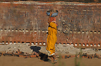 Carrying a heavy load is normal forthe women in India, a construction site, on the road from Mumbai to Goa,India