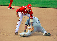 29 May 2011: Washington Nationals infielder Danny Espinosa is unable to get San Diego Padres right fielder Chris Denorfia out in the top of the 8th inning at Nationals Park in Washington, District of Columbia. The Padres defeated the Nationals 5-4 to take the rubber match of their 3-game series. Mandatory Credit: Ed Wolfstein Photo