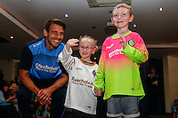 Wycombe Wanderers new goalkeeper jerseys are modelled by two young supporters during the 2016/17 Kit Launch of Wycombe Wanderers to the public at Adams Park, High Wycombe, England on 10 July 2016. Photo by David Horn.