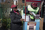 West Ham United 2 Crystal Palace 2, 02/04/2016. Boleyn Ground, Premier League. Two programme sellers on the corner of Green Street and Castle Street near the Boleyn Ground before West Ham United hosted Crystal Palace in a Barclays Premier League match. The Boleyn Ground at Upton Park was the club's home ground from 1904 until the end of the 2015-16 season when they moved into the Olympic Stadium, built for the 2012 London games, at nearby Stratford. The match ended in a 2-2 draw, watched by a near-capacity crowd of 34,857. Photo by Colin McPherson.
