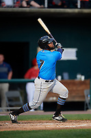 Akron RubberDucks first baseman Nellie Rodriguez (7) follows through on a swing during a game against the Harrisburg Senators on August 18, 2018 at FNB Field in Harrisburg, Pennsylvania.  Akron defeated Harrisburg 5-1.  (Mike Janes/Four Seam Images)