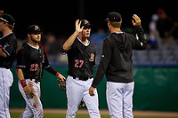 Batavia Muckdogs Troy Johnston (27) and J.D. Orr (22) high five teammates after a NY-Penn League game against the State College Spikes on July 2, 2019 at Dwyer Stadium in Batavia, New York.  Batavia defeated State College 1-0.  (Mike Janes/Four Seam Images)