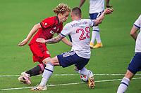 ORLANDO, FL - APRIL 24: Jacob Shaffelburg #24 of Toronto FC battles for the ball during a game between Vancouver Whitecaps and Toronto FC at Exploria Stadium on April 24, 2021 in Orlando, Florida.