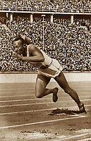 1936, Berlin Olympic Stadium, Berlin, Germany; James Cleveland Jesse Owens at the 1936 Olympic Games. Owens was an American track and field athlete and four-time Olympic gold medalist. <br /> <br /> <br /> <br /> James Cleveland Jesse Owens AT The 1936 Olympic Games Olympic Games Olympia He what to American Track and Field Athlete and Four Time Olympic Gold Medal List