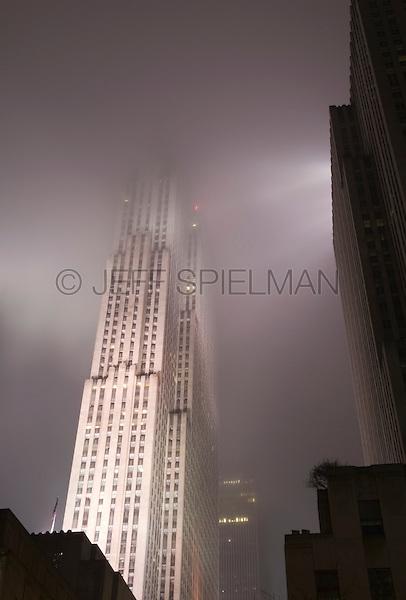 AVAILABLE FROM JEFF AS A FINE ART PRINT.<br /> <br /> AVAILABLE FROM JEFF FOR LICENSING.<br /> <br /> Upward View of 30 Rockefeller Plaza (also known as the GE Building/previously known as the RCA Building) on a Foggy Night, Rockefeller Center, Midtown Manhattan, New York City, New York State, USA