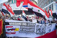 """250 bis 300 Menschen demonstrierten am Samstag den 31. Oktober 2015 in Berlin fuer die Unterstuetzung des syrischen Diktators Assad durch Russland. Sie trugen Fahnen Syriens, der ehemaligen Sowietunion, Russlands, Nordkoreas, der DDR, des Iran und Venezuelas, die sich """"alle zusammen gegen den Imperialismus zur Wehr setzen"""" wuerden. Russlands Praesident Putin wurde ausdruecklich fuer sein Militaerengagement gedankt, das Eingreifen der USA verurteilt.<br /> Im Bild 2.vl. am weissen Transparent: Marc Kluge, laut Szeneinsidern ist er langjaehriger Neonaziaktivist. In Magdeburg, war er fuer den """"Selbstschutz Sachsen-Anhalt"""" aktiv und NPD-Kandidat.<br /> 31.10.2015, Berlin<br /> Copyright: Christian-Ditsch.de<br /> [Inhaltsveraendernde Manipulation des Fotos nur nach ausdruecklicher Genehmigung des Fotografen. Vereinbarungen ueber Abtretung von Persoenlichkeitsrechten/Model Release der abgebildeten Person/Personen liegen nicht vor. NO MODEL RELEASE! Nur fuer Redaktionelle Zwecke. Don't publish without copyright Christian-Ditsch.de, Veroeffentlichung nur mit Fotografennennung, sowie gegen Honorar, MwSt. und Beleg. Konto: I N G - D i B a, IBAN DE58500105175400192269, BIC INGDDEFFXXX, Kontakt: post@christian-ditsch.de<br /> Bei der Bearbeitung der Dateiinformationen darf die Urheberkennzeichnung in den EXIF- und  IPTC-Daten nicht entfernt werden, diese sind in digitalen Medien nach §95c UrhG rechtlich geschuetzt. Der Urhebervermerk wird gemaess §13 UrhG verlangt.]"""
