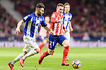 Kevin Gameiro of Atletico de Madrid (R) in action against Ruben Duarte of Deportivo Alaves (L) during the La Liga 2017-18 match between Atletico de Madrid and Deportivo Alaves at Wanda Metropolitano Stadium on 16 December 2017 in Madrid, Spain. Photo by Diego Souto / Power Sport Images