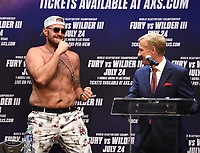 """LOS ANGELES, CA - JUNE 15: Boxers Tyson Fury stands behind announcer Jimmy Lennon Jr. at a press conference for the FOX Sports PPV """"Tyson Fury vs. Deontay Wilder III"""" at The Novo by Microsoft at LA Live on June 15, 2021 in Los Angeles, California. Fury vs. Wilder will be on July 24 at the T-Mobile Arena in Las Vegas. (Photo by Frank Micelotta/HULU/PictureGroup)"""