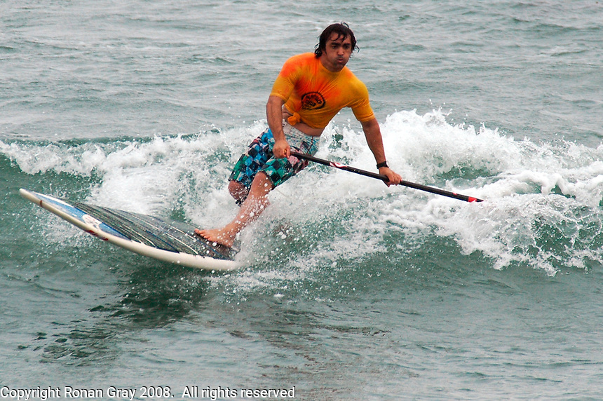 Saturday, June 14, 2008, Tourmaline Surf Park, Pacific Beach, San Diego, CA, USA.  Yann Quilfen competes in the Stand-Up Paddle competition during the Pacific Beach Surf Club's Tenth Annual Longboard Classic at Tourmaline Surfing Park.  The event was well attended despite gray, June gloom clouds and fickle, windy surf conditions.