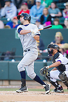 Bubba Starling (16) of the Wilmington Blue Rocks follows through on his swing against the Winston-Salem Dash at BB&T Ballpark on April 5, 2014 in Winston-Salem, North Carolina.  The Dash defeated the Blue Rocks 3-2.  (Brian Westerholt/Four Seam Images)